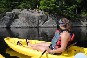 A perfect Adirondack Summer weekend includes cliff jumping into a beautiful lake after a short kayak trip from your vacation rental.