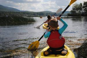Family canoe trip on Raquette River in Tupper Lake, NY
